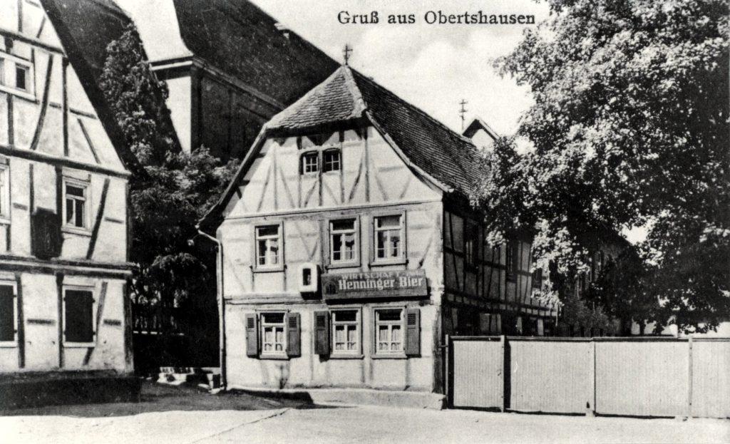 """Das Gasthaus """"Zum grünen Baum"""" auf einer alten Postkarte um 1920."""