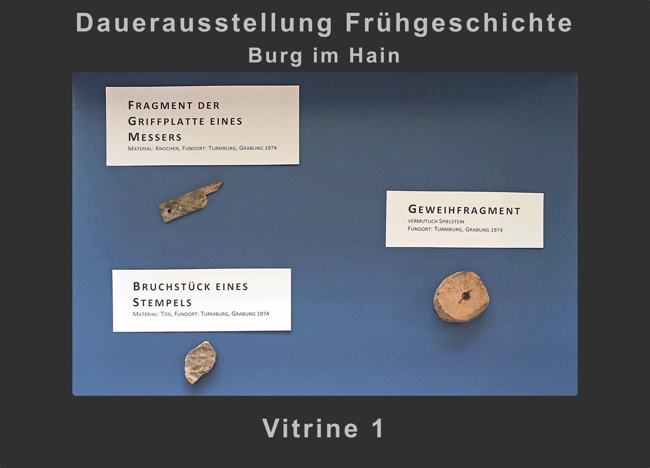 Vitrine 1: Messergriff, Stempel, Spielstein